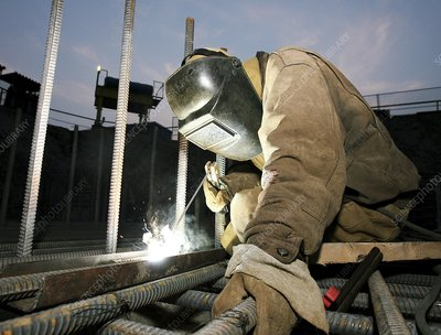Welder working on a new bridge