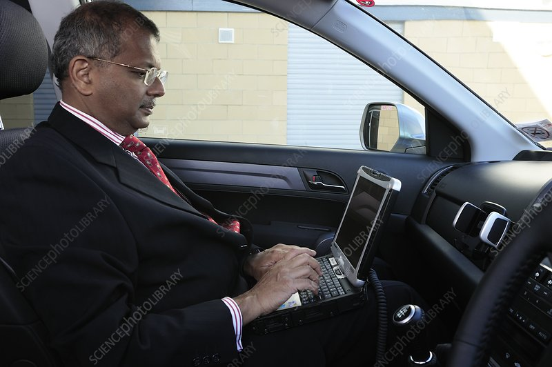 Doctor on call using a laptop