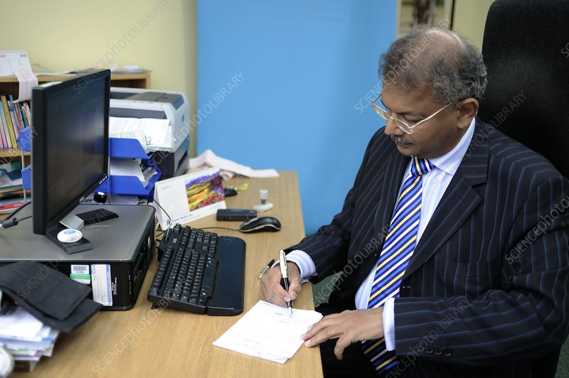 Doctor writing a sick note