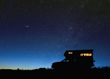 Camper van under starry sky