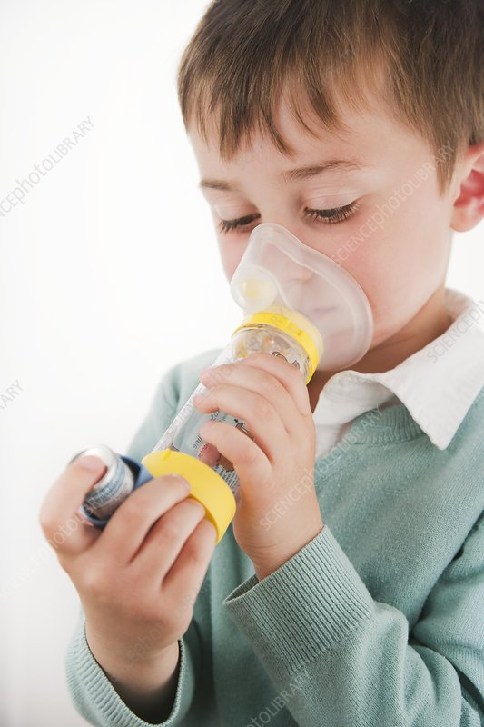 A child using an inhaler used with spacer