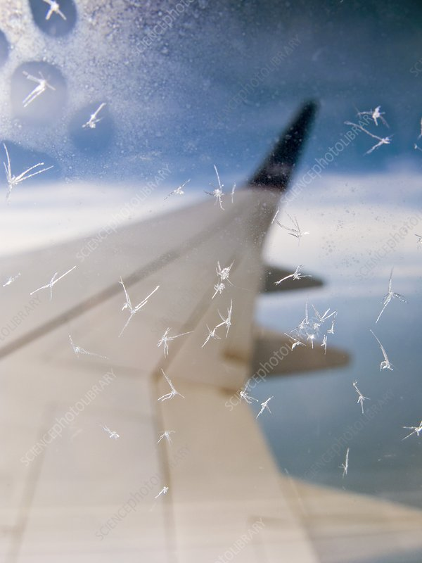 Aircraft window ice crystals