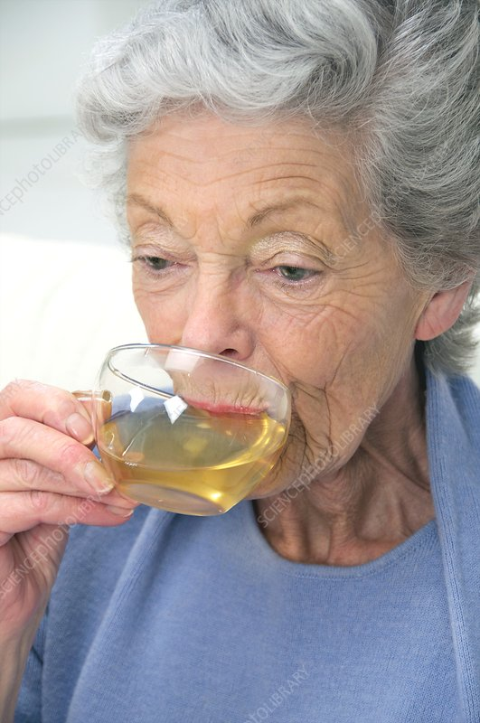 Elderly woman drinking herbal tea