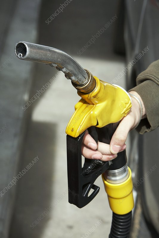 Woman holding a fuel pump