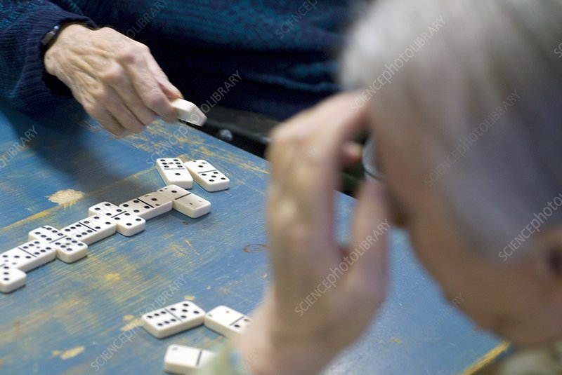 Elderly people playing dominoes