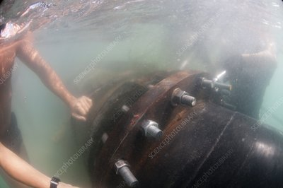 Laying a pipe underwater