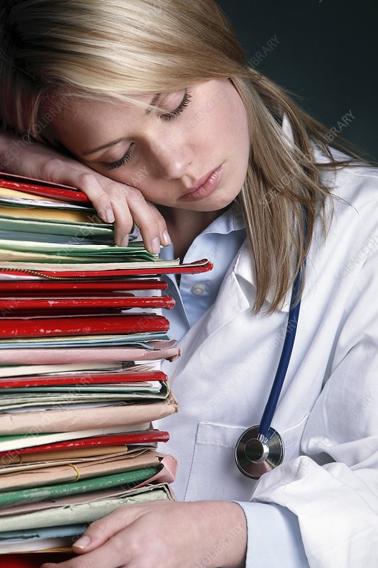 Over worked doctor conceptual image