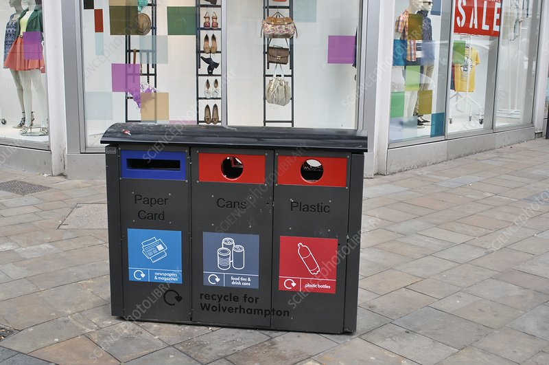 Recycling bins in front of fashion shop