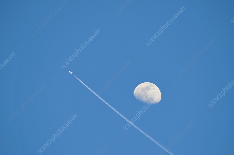 Day time moon and jet plane
