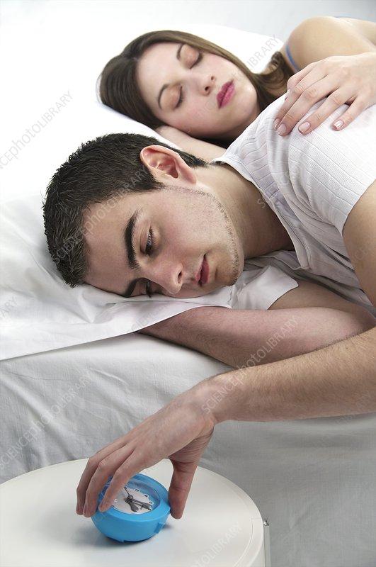 Couple woken by alarm clock