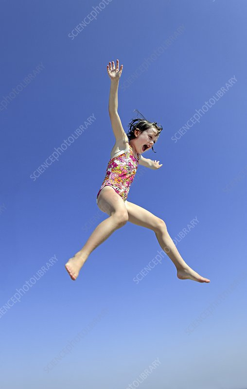 Girl jumping into water