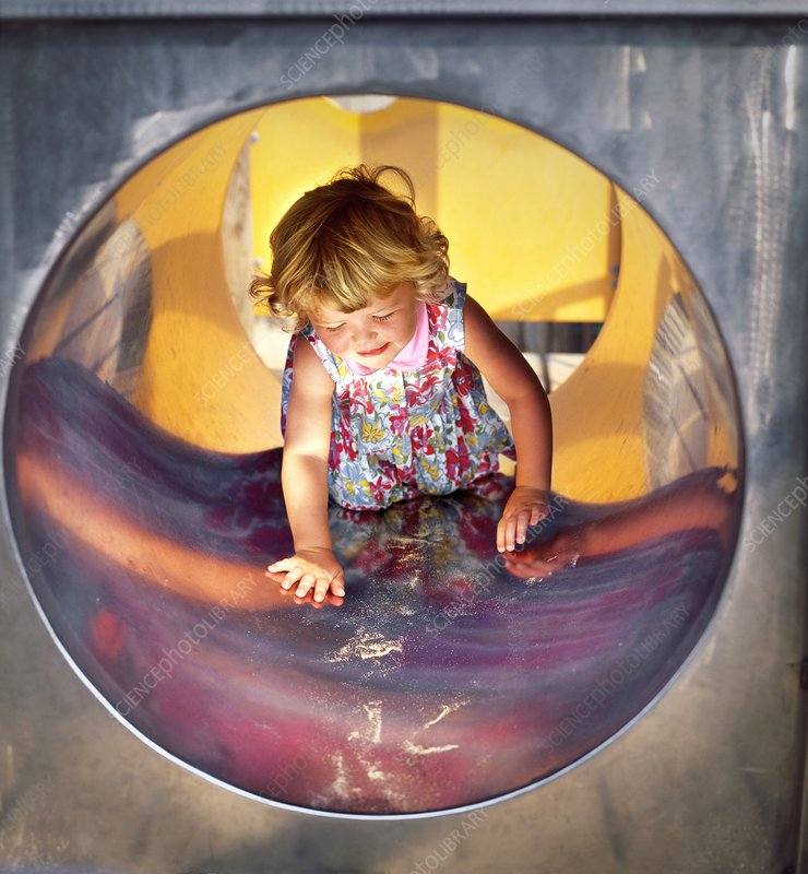 Girl in a playground tunnel