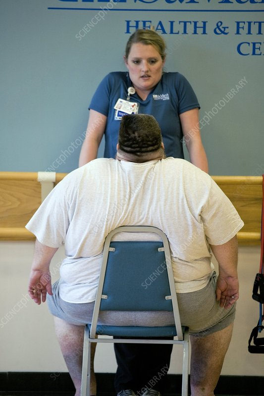 Obese man exercising, USA