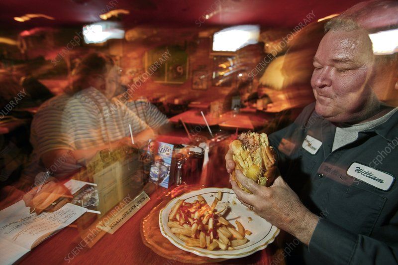 Man eating a hamburger, USA