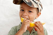 Boy eating a melon slice