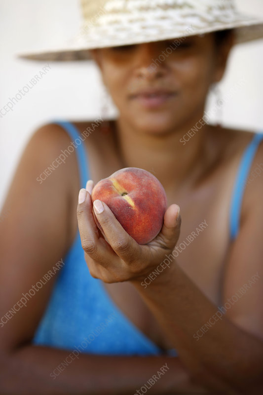 Woman eating a nectarine