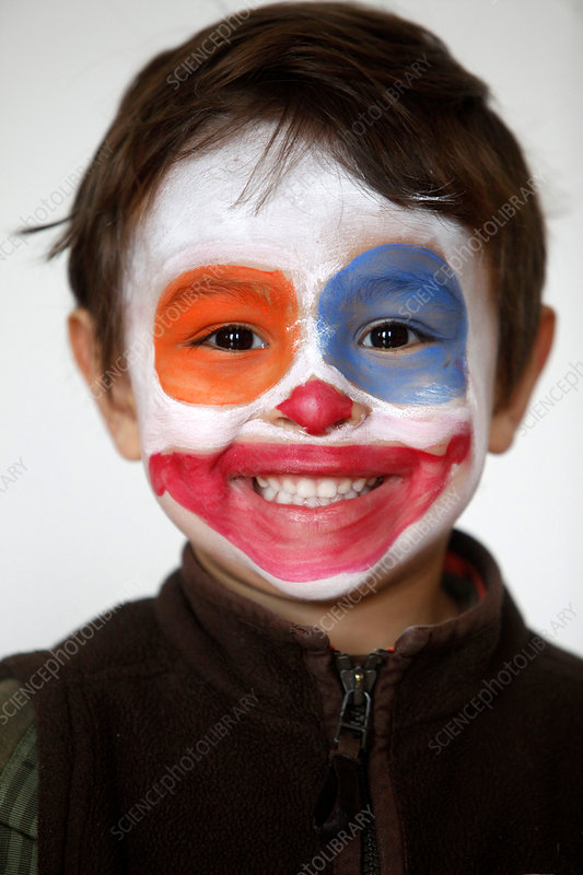 Boy painted with a clown's face