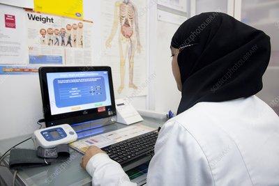 Female GP doctor at a workstation