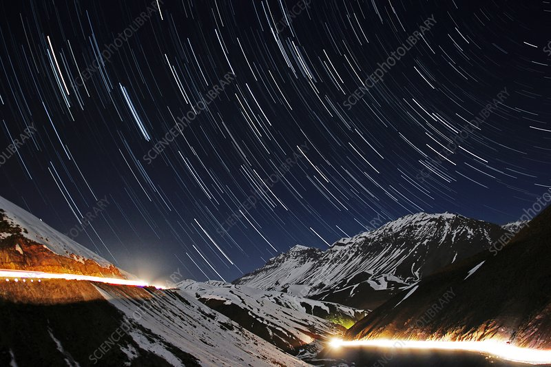 Star trails over a mountain road, Iran