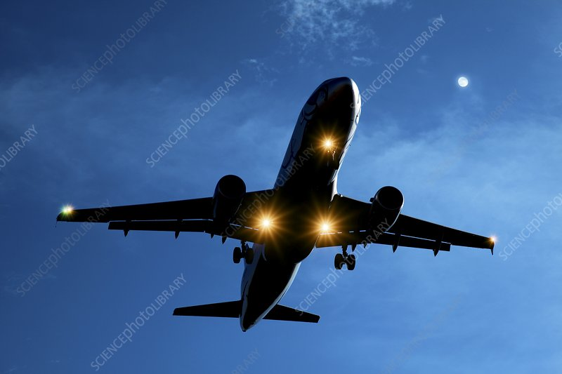 Airbus A320 airliner landing at night - Stock Image - C011/6923
