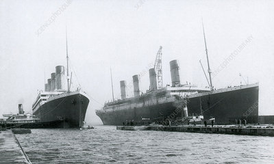 Titanic and Olympic leaving the shipyard