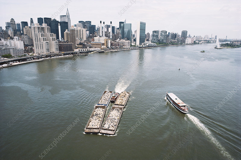 Garbage Scow on East River, NYC, USA