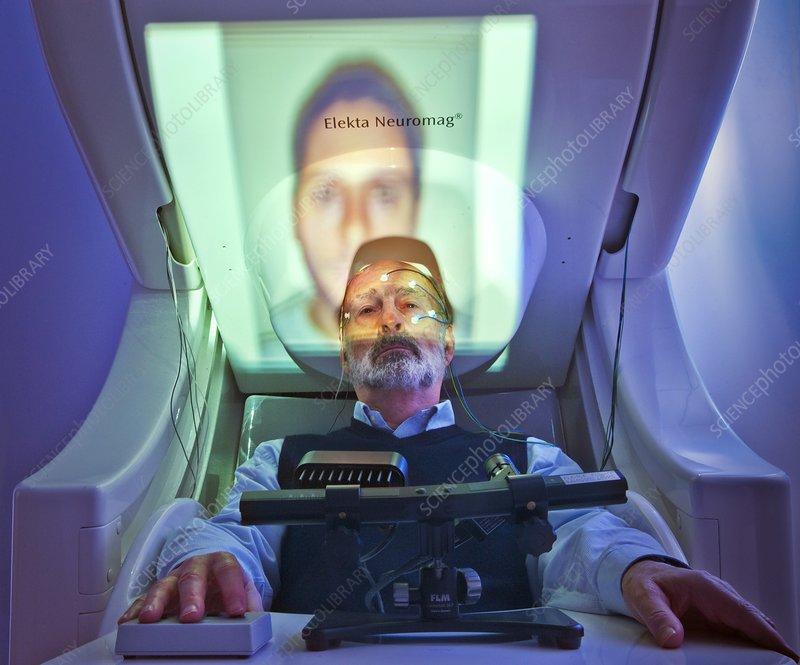 Older man in MEG scanner