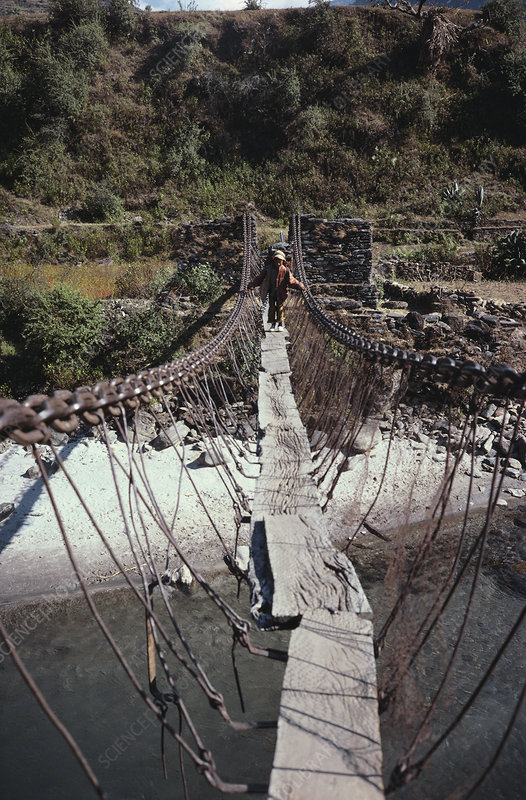 Sherpa Boy Crossing Bridge, Nepal