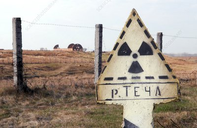 Radiation sign outside abandoned village