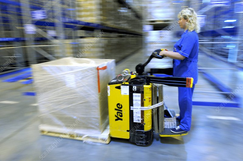 Warehouse worker with pallet truck