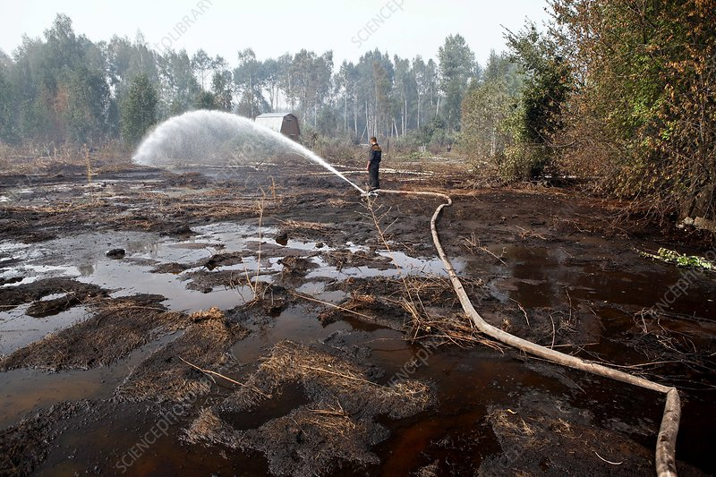 Flooding peat bogs to extinguish fire