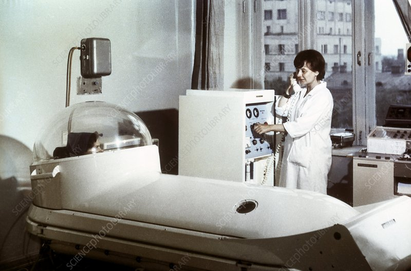 Patient inside early hyperbaric chamber