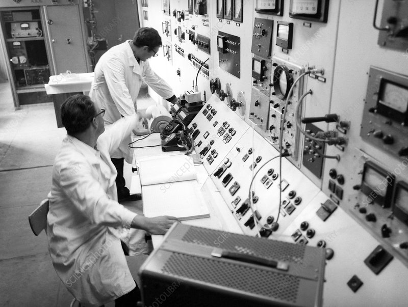 Scientists at linear accelerator controls