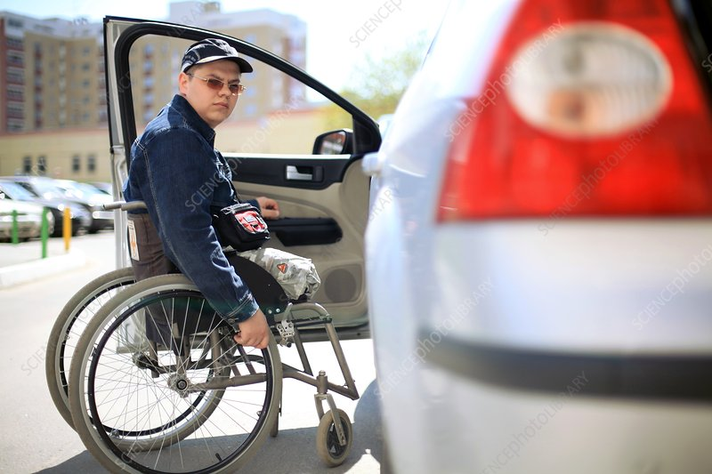 Disabled soldier with his car