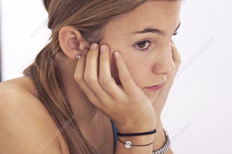 Pensive teenage girl