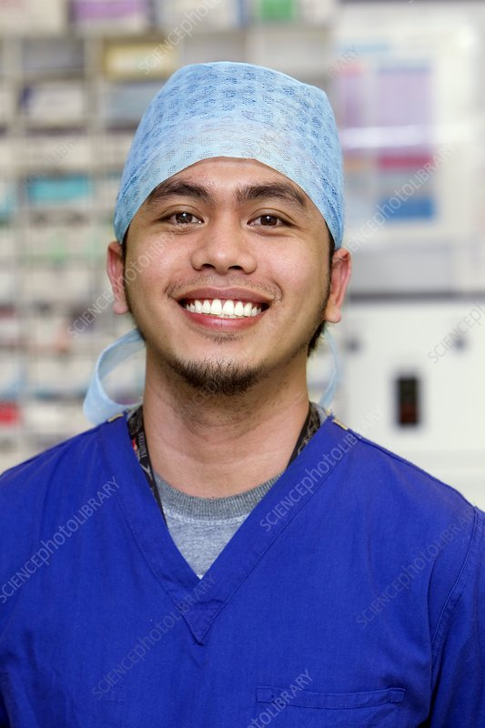 Surgical team member smiling
