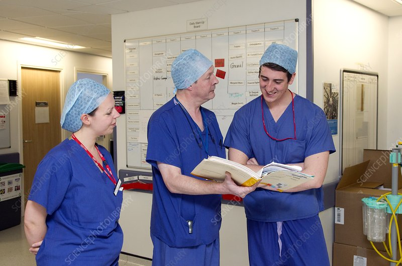 Surgeons discussing patient notes