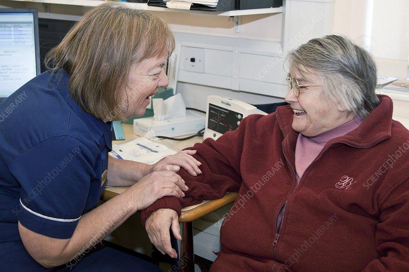 Practice nurse and patient