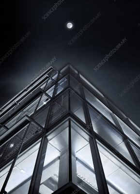 Moon over a building