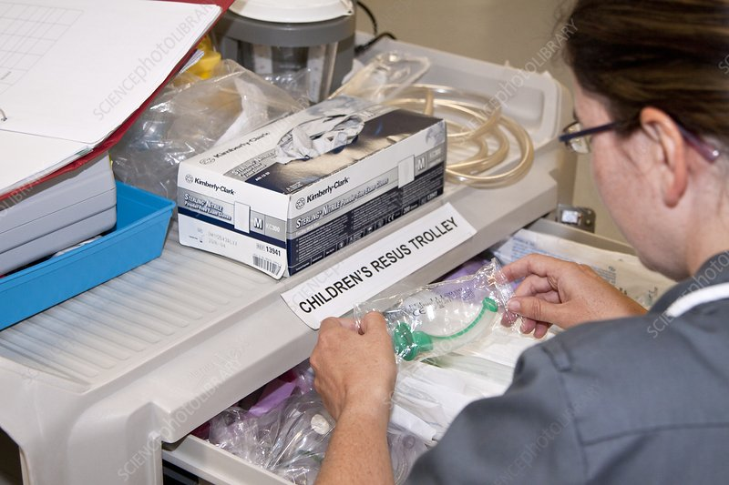 Nurse checking resuscitation supplies