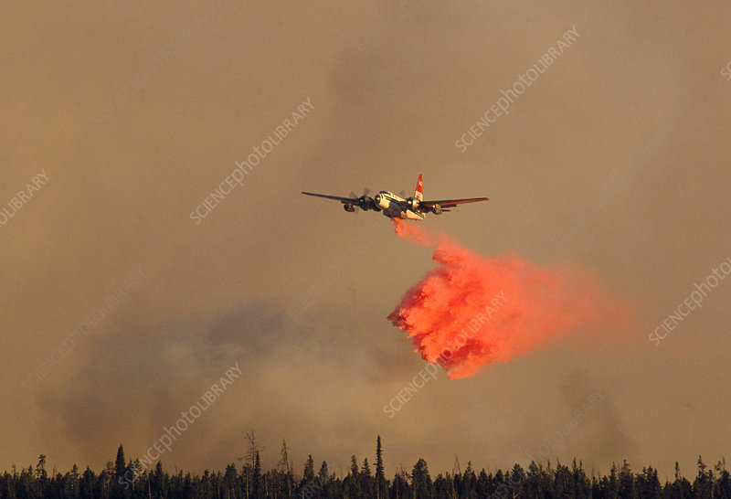 Firefighting plane dropping chemicals