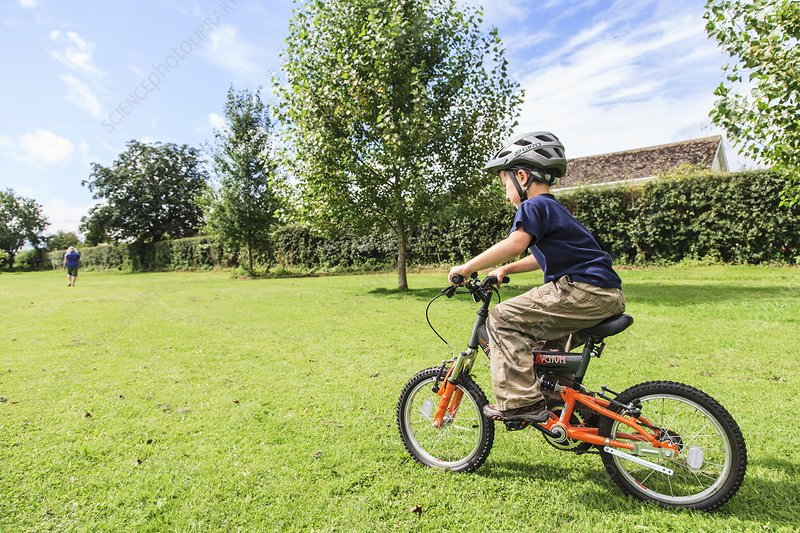 Boy learning to ride a bicycle
