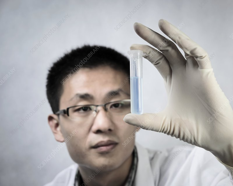 Scientist holding a test tube