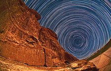 Star trails over rock carvings