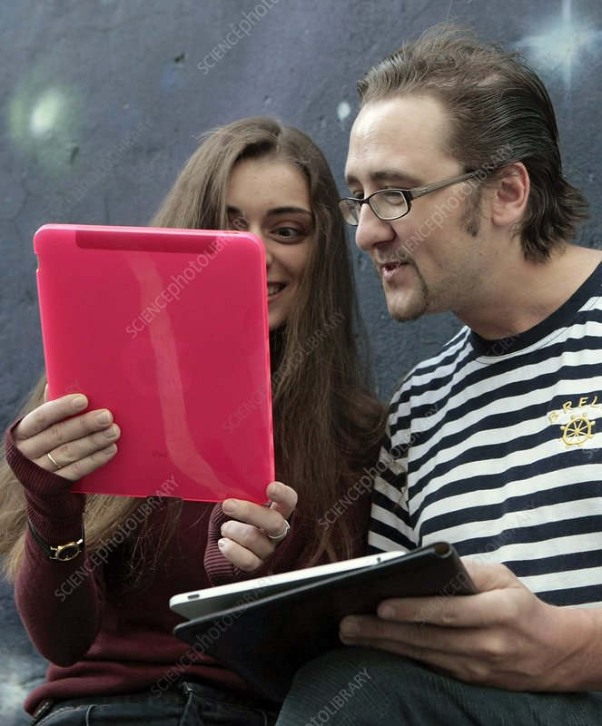 Couple using iPads