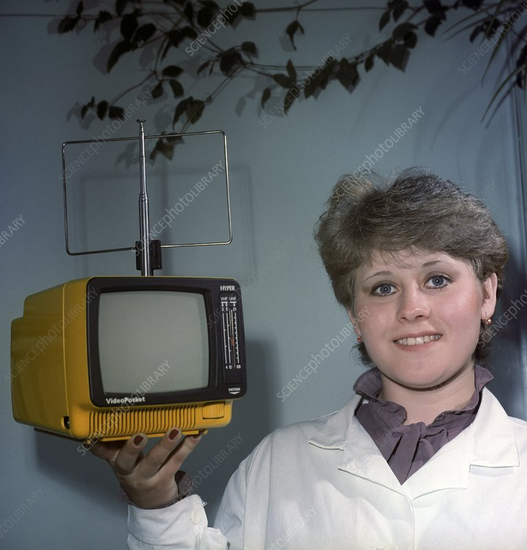 Woman holding a small television