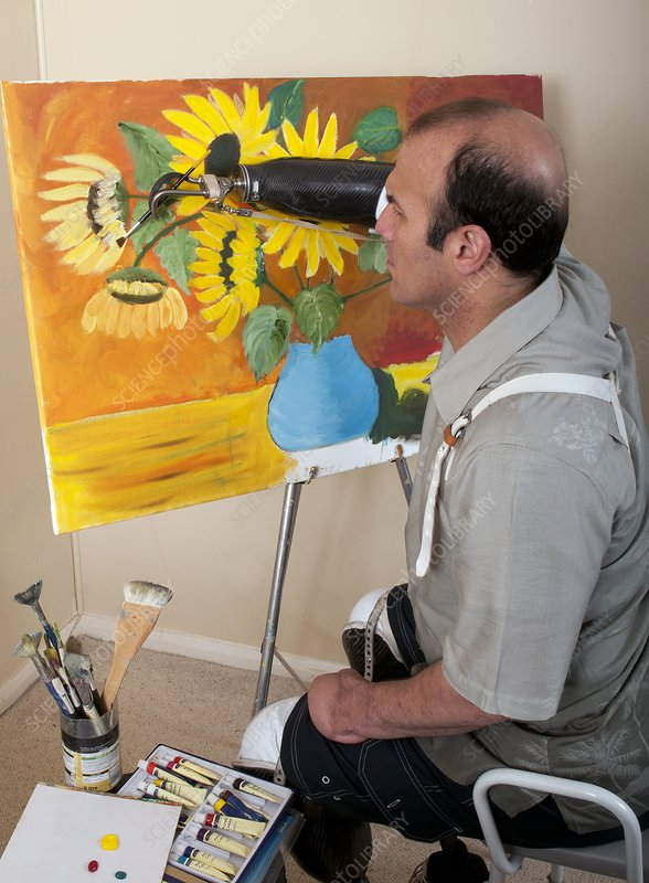 Amputee painting using prosthetic hand