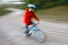 Teenage boy riding a bike at speed