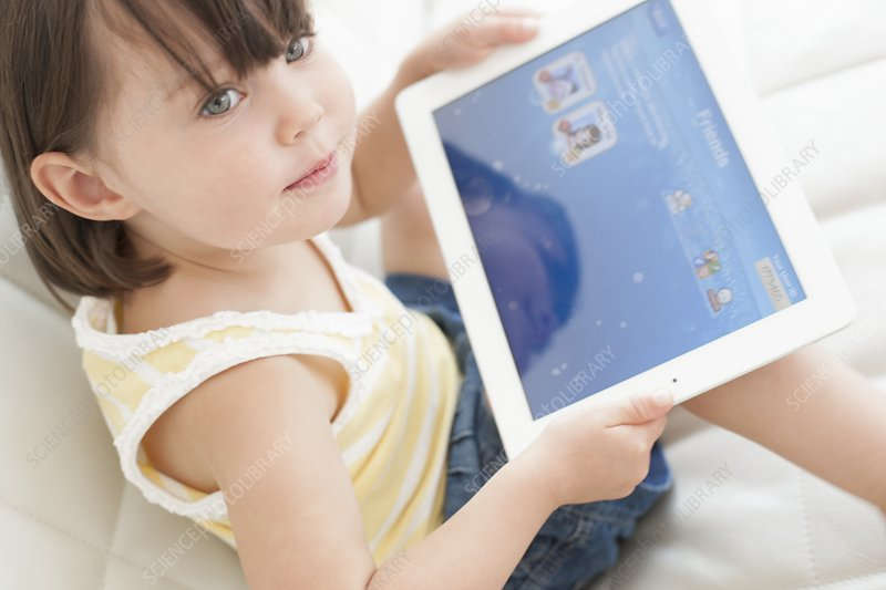 Toddler using a tablet computer