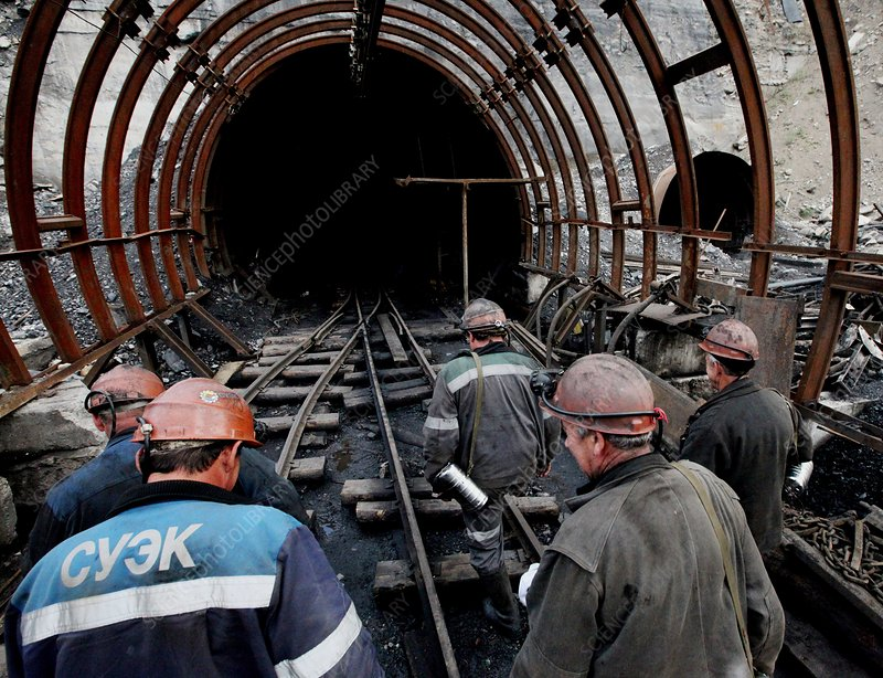 Miners entering a pit